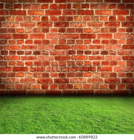Red brick wall with grass floor in room style - stock photo