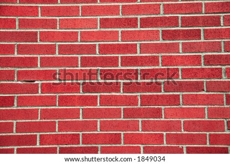 Red Brick Wall with gray mortar. - stock photo