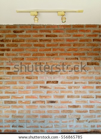 Red brick wall with light