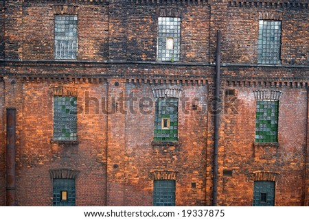 Red brick wall with mosaic windows. Old factory in Saint Petersburg ('Red Triangle')