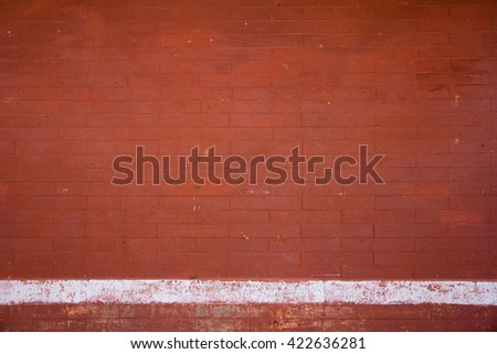 Red brick wall with white chalk line - stock photo