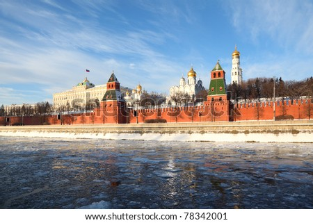 Red brick walls of famous Kremlin and Ivan Great Bell Tower at winter in Moscow, Russia - stock photo