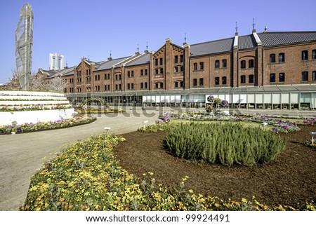 Red Brick Warehouse at the flowers garden in Yokohama - stock photo