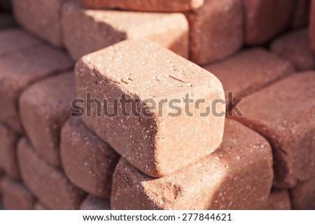 Red bricks be stacked(be heaped, pile up) up make background at the daylight in the morning.   - stock photo
