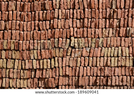 Red bricks drying in the sun on a moroccan workshop - stock photo