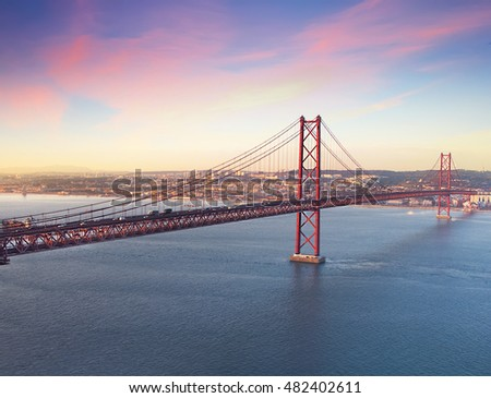Red bridge at season sunset, Lisbon, Portugal. Vintage colored picture Love and travel concept