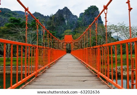 Red bridge over song river, vang vieng, laos - stock photo