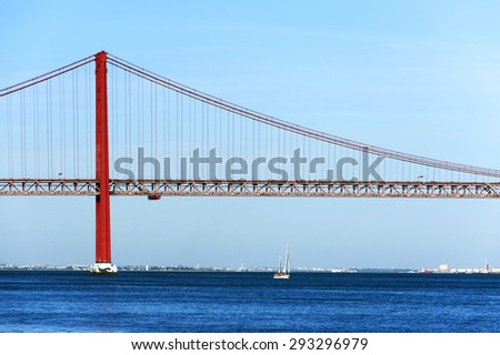 Red bridge over the Tagus river in Lisbon, Portugal - stock photo