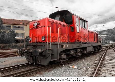 Red bright diesel locomotive - stock photo