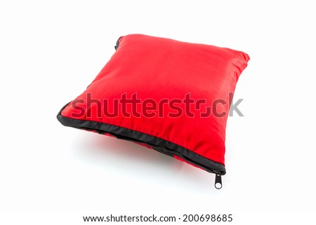 Red bright pillow with zipper on white background. - stock photo