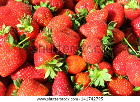 red bright strawberry background close-up