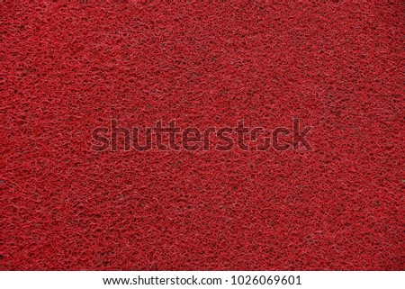 Red bright synthetic texture of foam rubber sponge