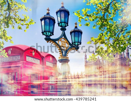 Red british phone box and lantern with traffic lights reflection - stock photo