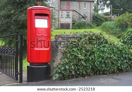 Red british postbox, letterbox, mailbox - stock photo