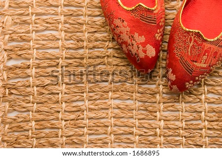 Red brocaded slippers worn by geishas and other women of the Japanese culture. - stock photo