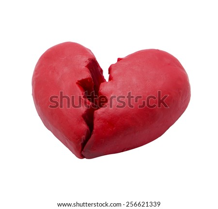 Red broken heart shape play dough isolated on white background.  - stock photo