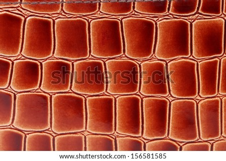 Red brown color of crocodile skin. Whole background. - stock photo