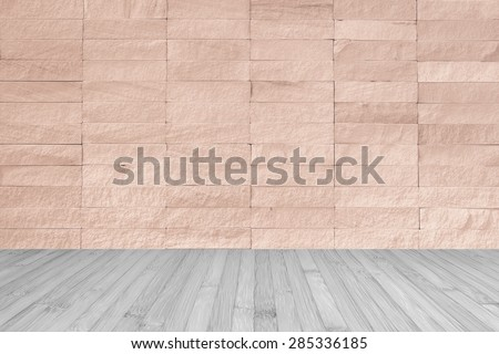 Red brown rock tile wall with wooden floor in light grey color tone for interior background     - stock photo