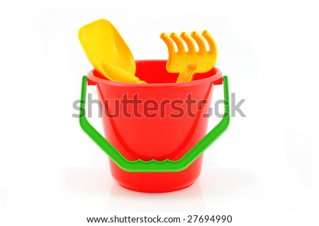 Red bucket wit sandpit toys - stock photo