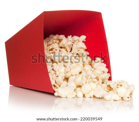 Red bucket with fallen out popcorn, isolated on the white background, clipping path included. - stock photo