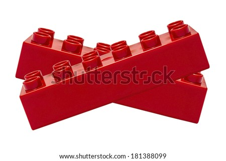 Red  building block closeup on white background