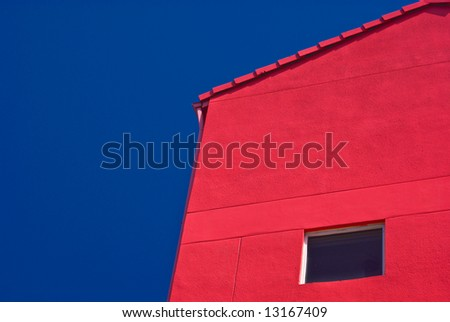 Red Building With One Window Against Cloudless Blue Sky - stock photo