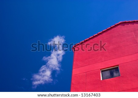 Red Building With One Window Against Partly Cloudy Blue Sky - stock photo