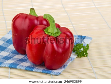 Red Bulgarian bell pepper on the wooden background - stock photo