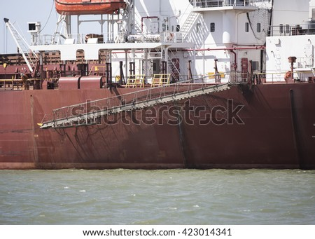 Red bulk ore carrier - stock photo