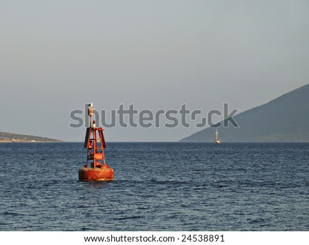 Red Buoy as Port Entry Navigation Light - stock photo