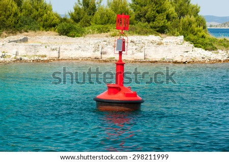 Red buoy in the Adriatic Sea. - stock photo