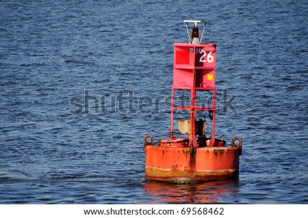 Red Buoy Marker in Water Horizontal With Copy Space - stock photo