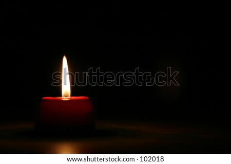 Red burning Candle - at night