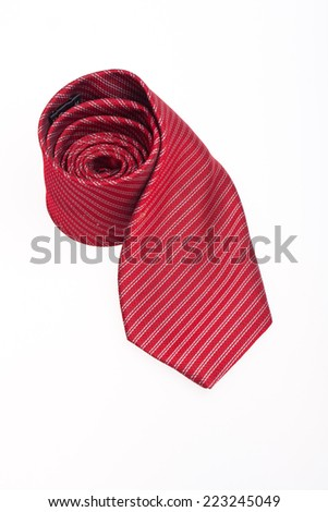 red business neck tie silk on white background.