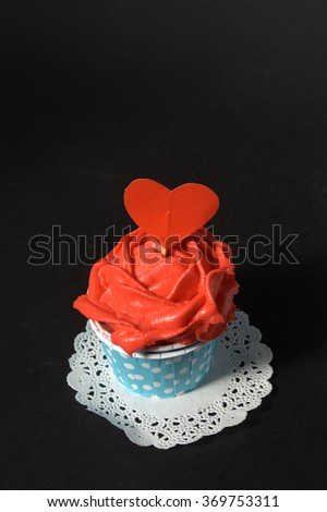 Red  butter cream cupcake - stock photo
