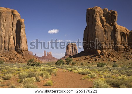 Red buttes and colorful spires of Monument Valley Navajo Tribal Park, Southern Utah near Arizona border - stock photo