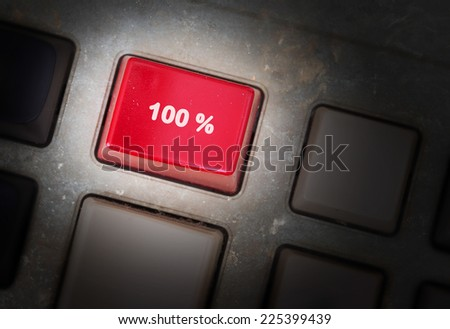 Red button on a dirty old panel, selective focus - 100% - stock photo