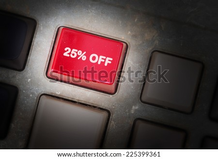 Red button on a dirty old panel, selective focus - 25% off - stock photo