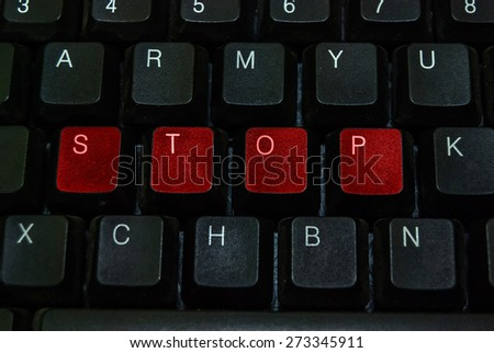 red button stop word on black computer keyboard - stock photo