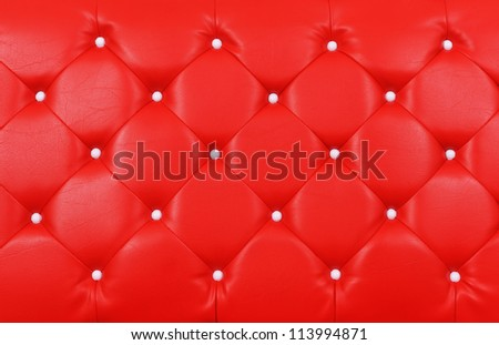 Red buttoned leather pattern - stock photo