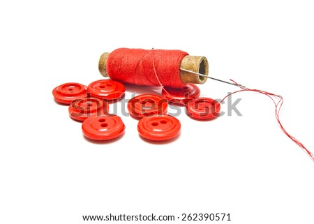 red buttons and thread on white background - stock photo