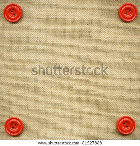 Red buttons on the beige fabric