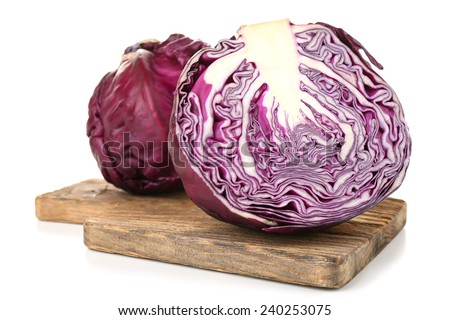 Red cabbage on cutting board isolated on white - stock photo