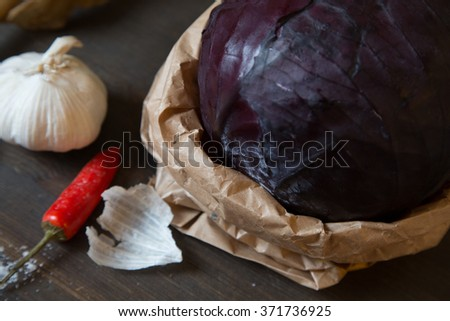 red cabbage on the table, garlic and red hot peppers on the table