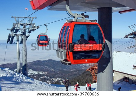red cable car in winter - stock photo