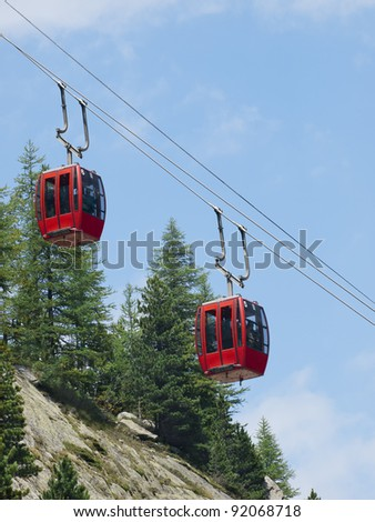 Red cable car lift at Chamonix mer de glace - stock photo