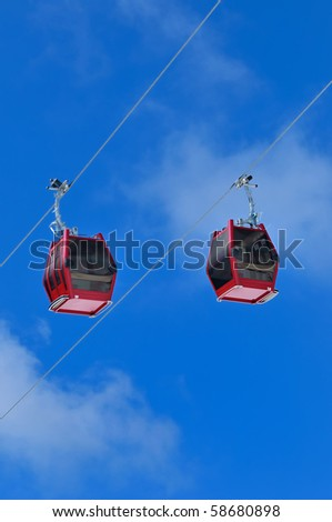 Red cable car on snow mountain, Chamrousse, France - stock photo