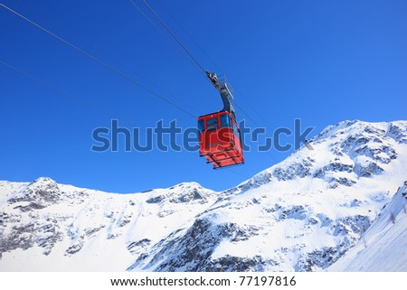 Red cable car railway, cableway, in ski resort - stock photo
