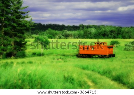 red caboose in field