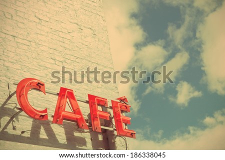 Red Cafe Sign Against Blue Sky with a Retro Effect  - stock photo